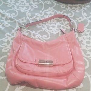 Smaller pink coach handbag